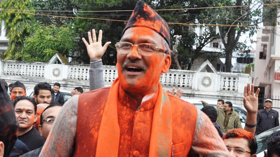 BJP workers hold up Trivendra Singh Rawat at the party office in Dehradun on March 11, 2017, after the assembly elections results were announced.