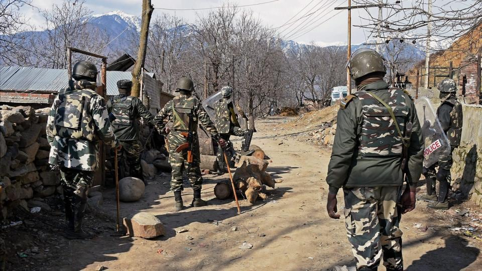 In this file photo from March 5,  CRPF jawans keep vigil on protesters during an encounter at Nigeen Pora in Tral of Pulwama district.