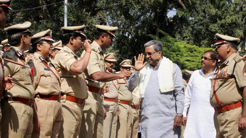 Karnataka chief minister Siddaramaiah greets the senior police officers during the Karnataka state senior police officers annual conference in Bengaluru.