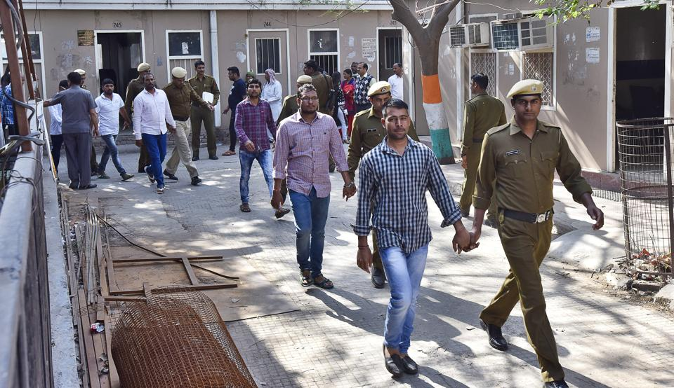Convicted Maruti workers who were taken into custody after the March 10 verdict in the 2012 Manesar plant violence case at the district court on Friday.
