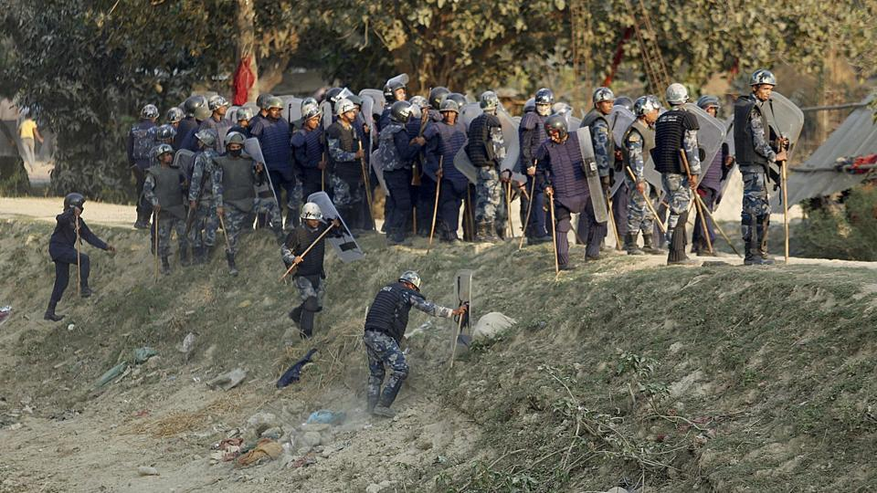 Nepalese police clash with Madhesi minority protesters at Raibiraj, Saptari District, some 240 kms southeast of Kathmandu on March 6, 2017. At least three people died and a dozen were injured in clashes between police and minority protesters in Nepal Monday, officials said, the first incidence of violence since long-delayed elections were announced.