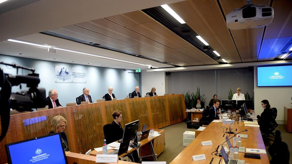 Officials from the Royal Commission into Institutional Responses to Child Sexual Abuse participate on the opening day of their public hearing into the Anglican Church of Australia in Sydney, Australia.