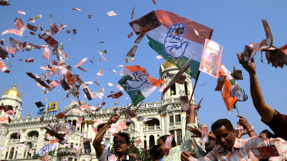 Congress workers throw fake notes in Kolkata in support of the Narada sting operation, which showed TMC leaders taking bribes.