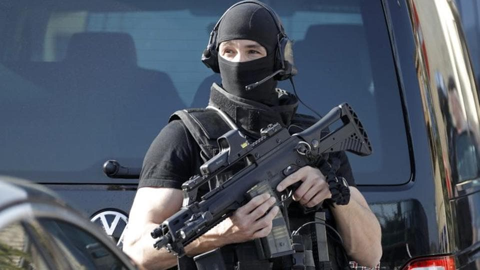 A member of special police unit RAID outside the Tocqueville high school after a shooting incident injured people in Grasse, southern France.