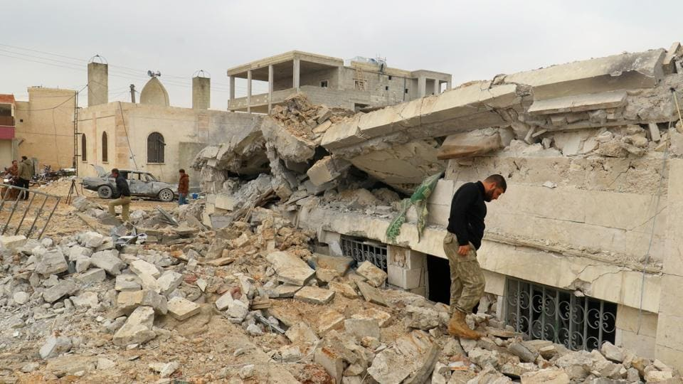 People inspect a damaged mosque after an airstrike on the rebel-held village of al-Jina, Aleppo province in northwest Syria on March 17.