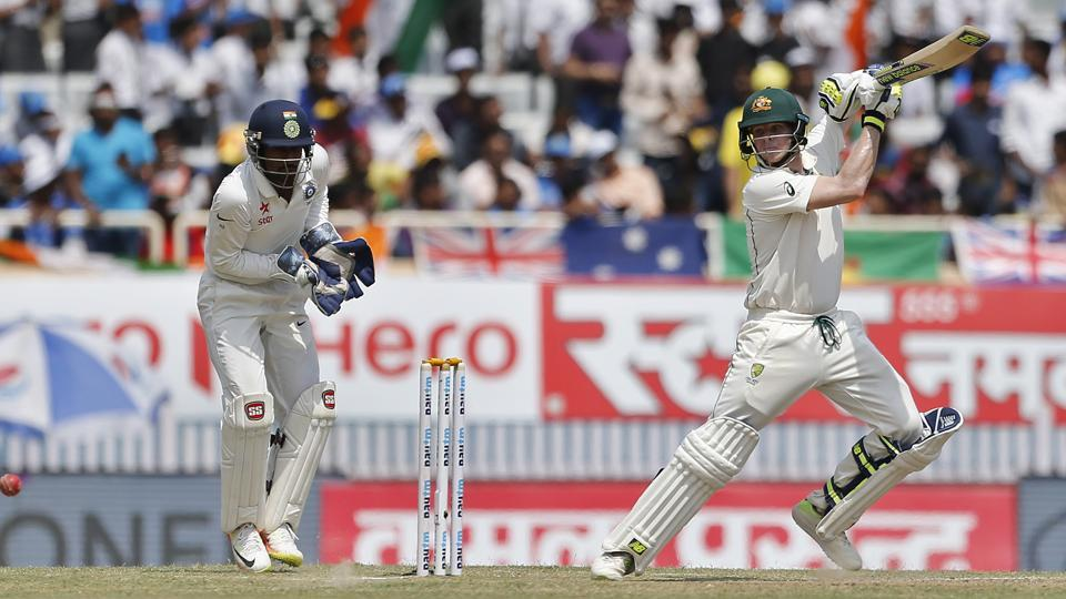 Australia's captain Steven Smith, right, plays a shot during the second day of their third Test match. (AP)