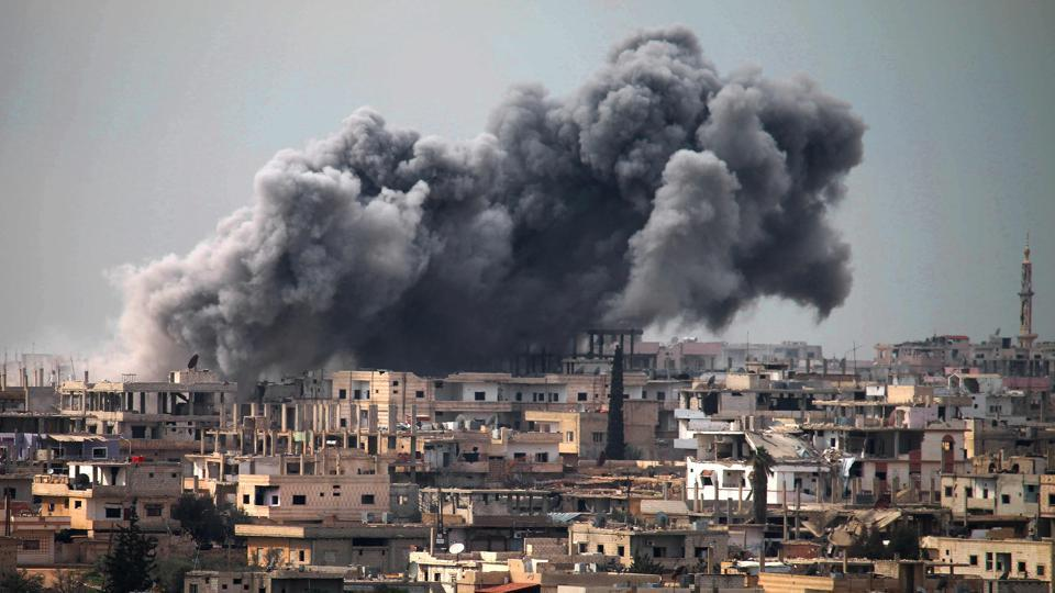Smoke billows following reported air strikes on a rebel-held area in the southern city of Daraa.