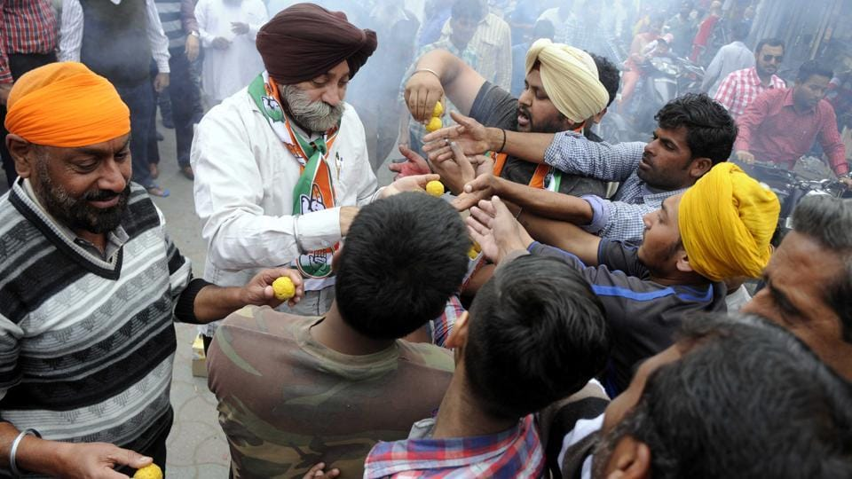 Congress workers in a jubilant mood, after Captain Amarinder Singh's oath-taking ceremony, in Patiala on Thursday.