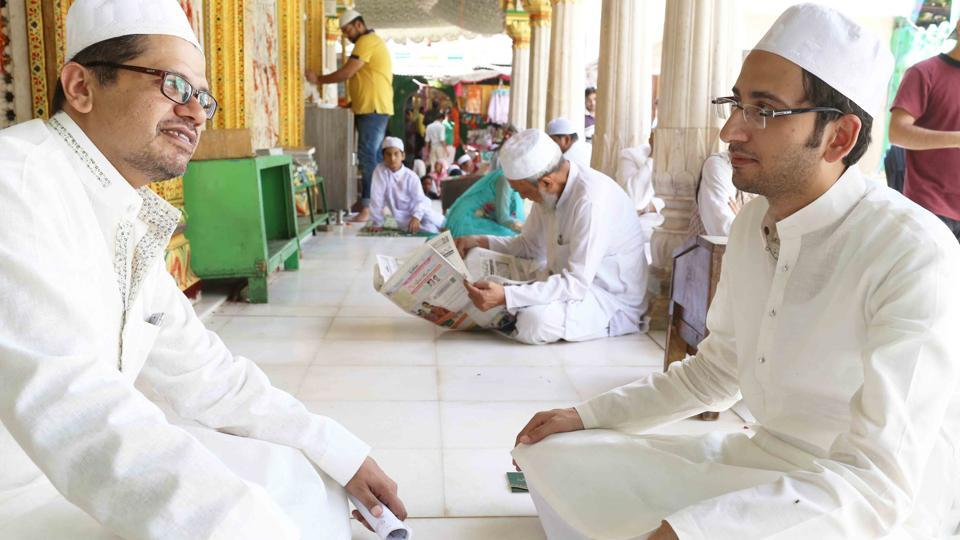 What you call the clerics of Nizamuddin dargah are actually sajjadanashins, successors to the sufis, or khadims, the people who do khidmat  (service) in the Dargah.