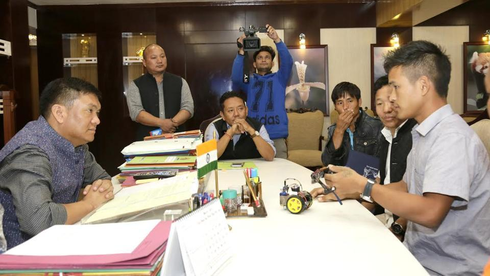 Anang Tadar (right), a class 11 student, explains how his innovation, the Goggles for Blind works, to Arunachal Pradesh chief minister Pema Khandu at Itanagar on Friday.
