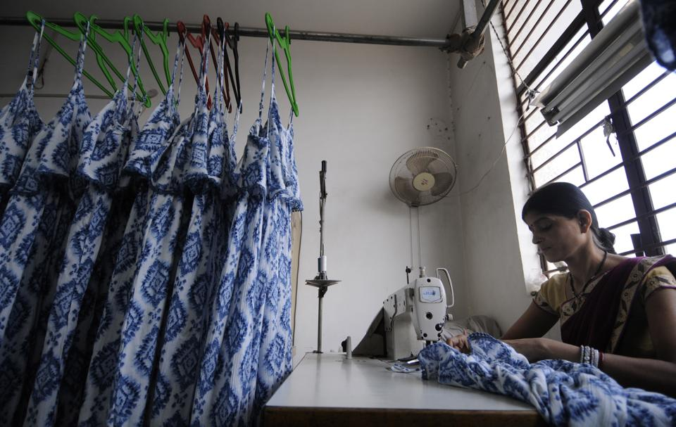 A woman seen stitching garments in Noida, near Delhi.