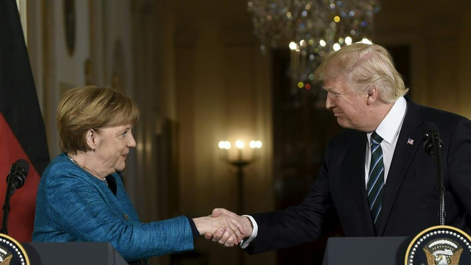 US President Donald Trump and Germany's Chancellor Angela Merkel shake hands after a press conference in the East Room of the White House on March 17 in Washington, DC.