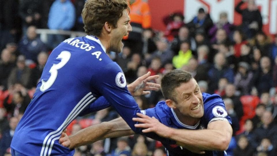 Gary Cahill of Chelsea Football Club (right) celebrates after scoring against Stoke City F.C. during their English Premier League match at the Britannia Stadium, Stoke on Trent, on Saturday.