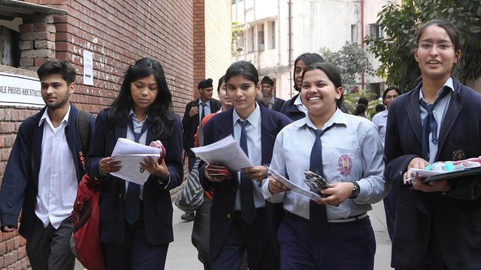 School children coming out from exam centre after appearing their CBSE Class 10 exam in New Delhi.