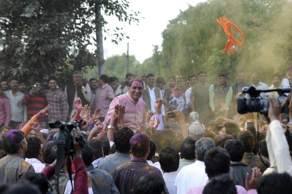 Tejpal Singh Nagar with his supporters after being declared the winner in the Dadri assembly segment on March 11.