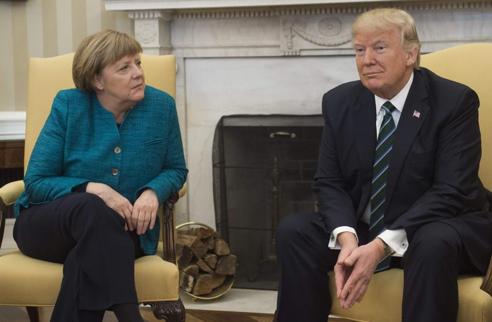 US President Donald Trump and German Chancellor Angela Merkel meet in the Oval Office of the White House in Washington, DC, on Friday.