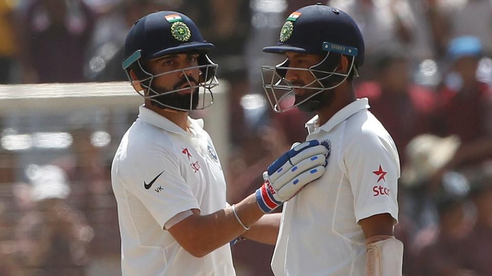 Cheteshwar Pujara (L) and Virat Kohli on Day 3 of the third Test between India and Australia in Ranchi.
