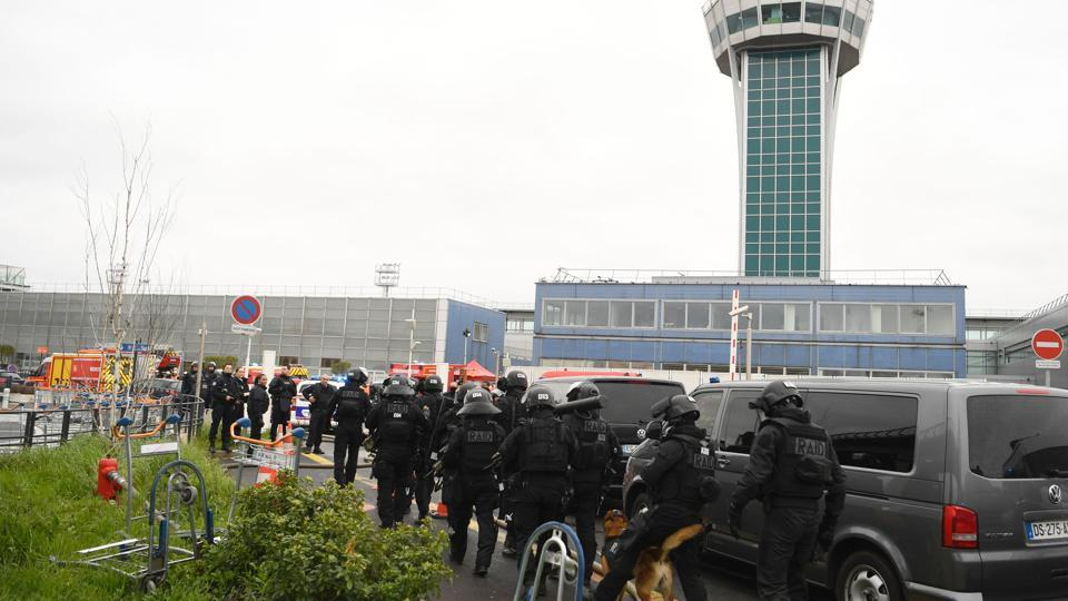 French Police unit (Raid) secure the area at Paris' Orly airport following the shooting of a man by French security forces. Security forces at Paris' Orly airport shot dead a man who took a weapon from a soldier, the interior ministry said.
