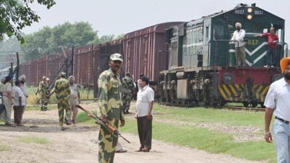 BSFjawan and police watching the Samjhauta Express crossing the Zero area of the India-Pakistan Border at Gurdaspur at Attari near Amritsar.