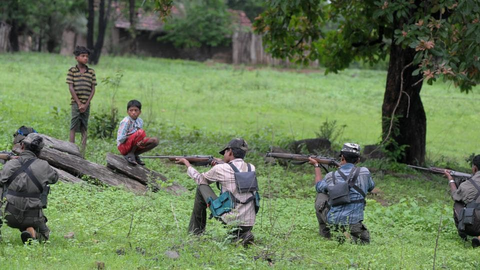 Maoist activists taking armed training in a wooded village area of Chhattisgarh even as villagers look on