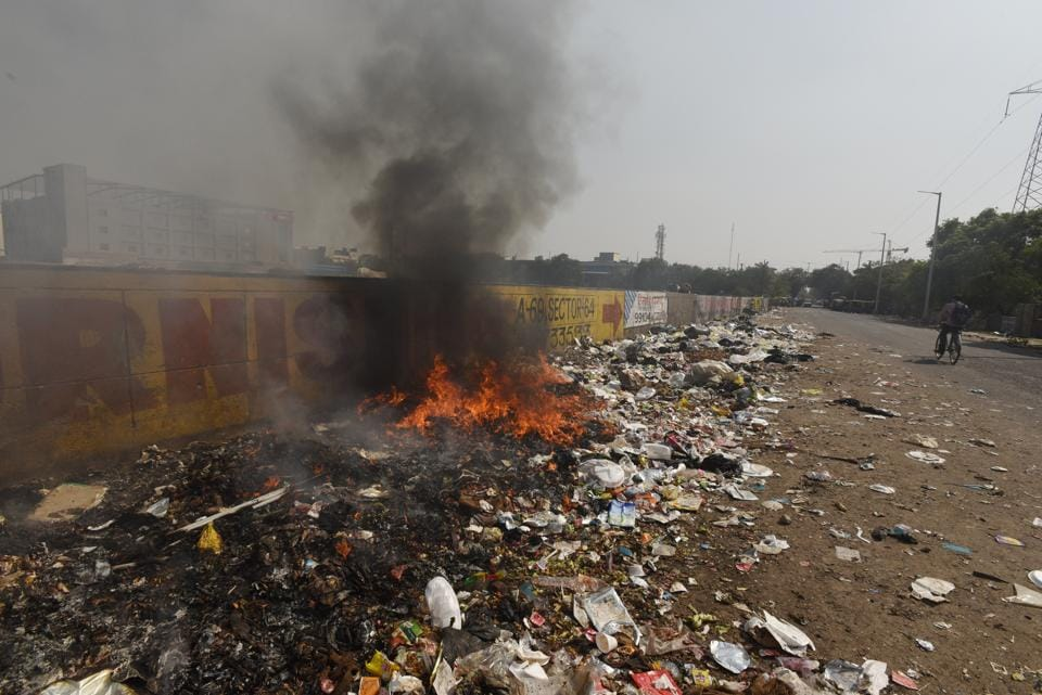 According to residents, waste is scattered over 500 metres on both sides of the road and it is common to see heaps of garbage burning.