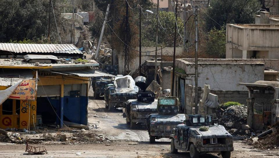 Military vehicles of Iraqi federal police are pictured during a battle between Iraqi forces and Islamic State militants, in Mosul, Iraq, March 17, 2017.