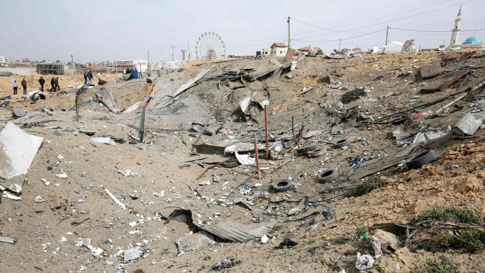 A picture taken on March 18, 2017 shows a blast crater at the site of a reported airstrike conducted by the Israeli military against a Hamas military training facility, north of Gaza City.