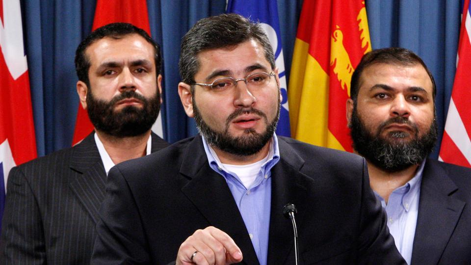 Abdullah Almalki (C), with Muayyed Nureddin (L) and Ahmad El Maati, speaks during a news conference on Parliament Hill in Ottawa October 12, 2007.