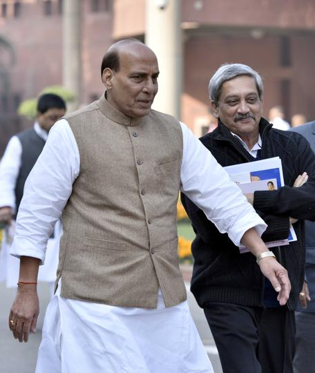 Home Minister Rajnath Singh with Minister of Defence, Manohar Parrikar at Parliament House, in New Delhi.