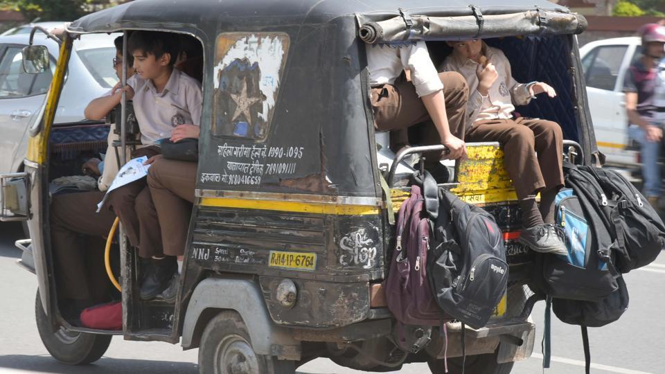 An overloaded auto ferries schoolchildren in Jaipur.