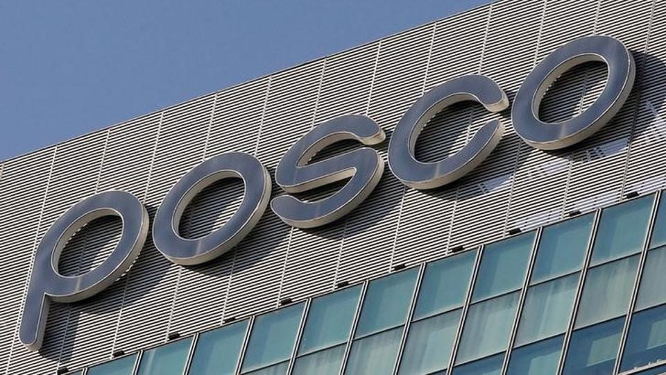 The logo of POSCO is seen at the company's headquarters in Seoul October 21, 2011.