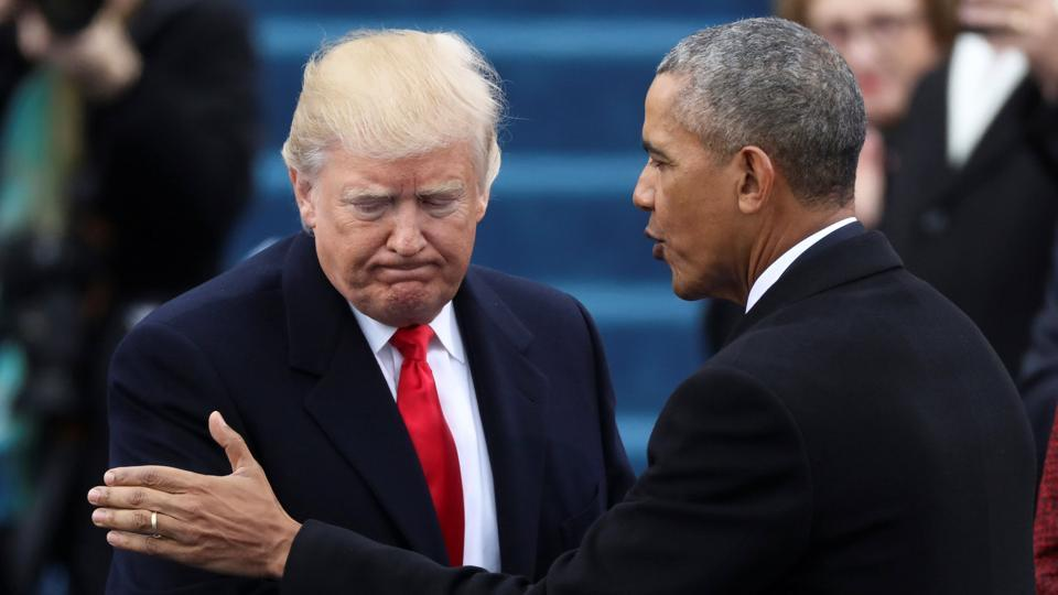 Former President Barack Obama (R) greets President Donald Trump at inauguration ceremonies on the West front of the US Capitol in Washington.