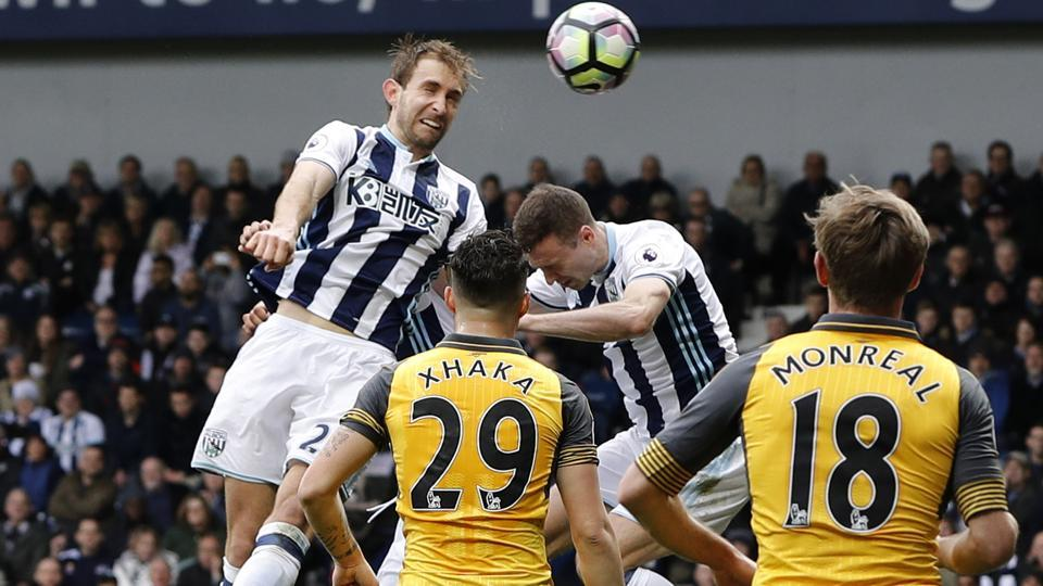 West Bromwich Albion F.C.'s Craig Dawson scores their third goal against Arsenal Football Club during their English Premier League match on Saturday
