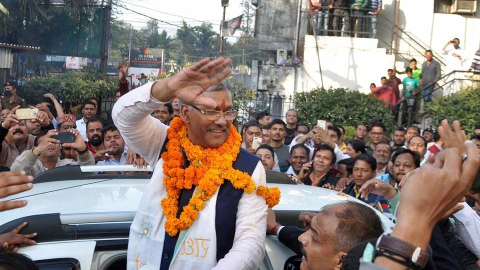 BJP leader Trivendra Singh Rawat being greeted by supporters after he was elected as the party's legislative party leader in Dehradun on Friday. He will be sworn in on Saturday.
