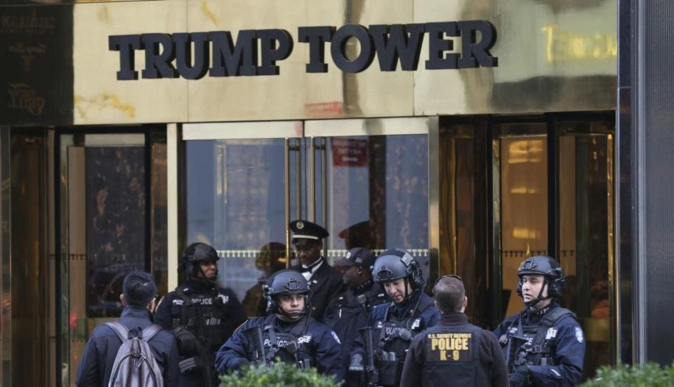 In this November 17, 2016 file photo, security personnel stand at the front entrance of Trump Tower in New York. The laptop stolen from a Secret Service agent on Friday reportedly contained details of floor plans of Trump Tower.