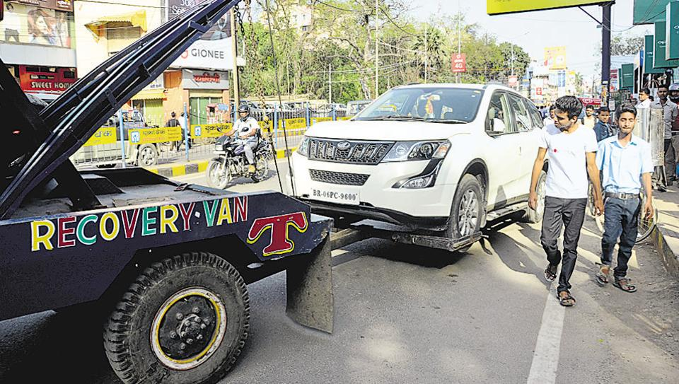 An illegally parked vehicle being towed away in Patna on Saturday.