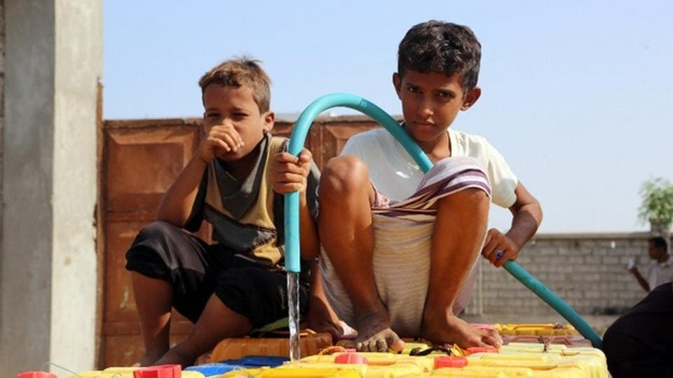 Yemeni children fill empty jerrycans with water from a donated source amid ongoing widespread disruption of water supplies in an impoverished coastal village on the outskirts of the Yemeni port city of Hodeidah.