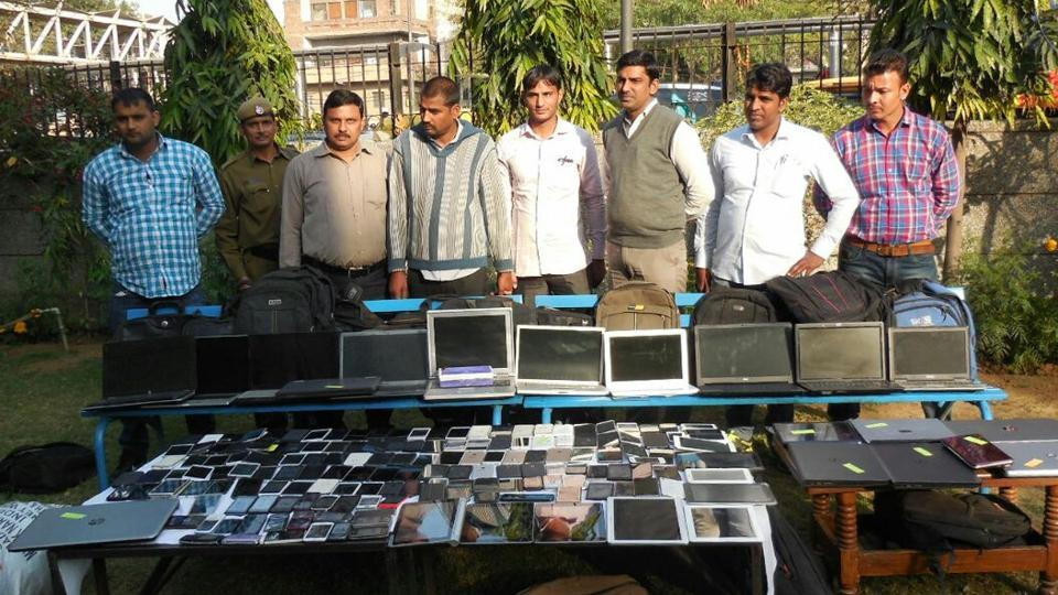 Cops display laptops and mobile phones seized from the shopkeepers.