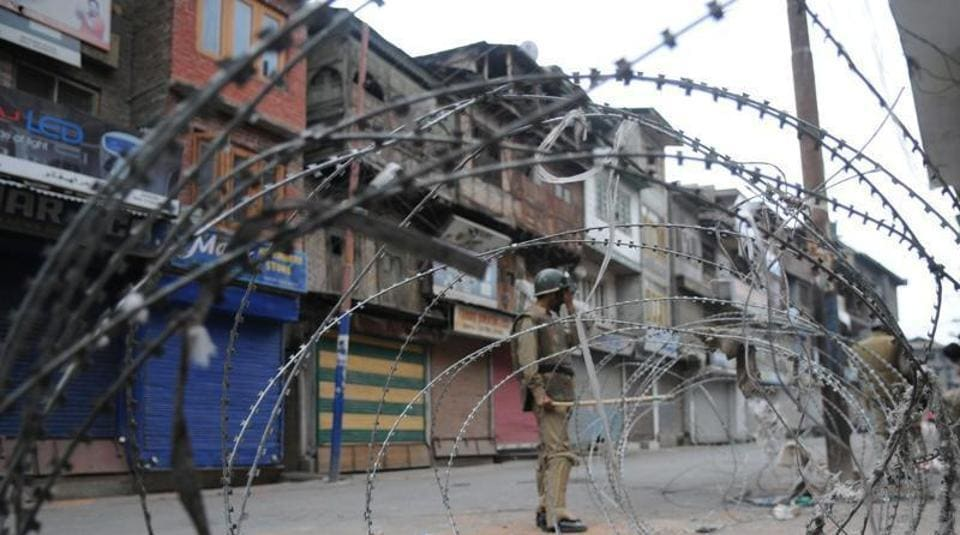 Police enforce curfew in Srinagar in July 2016 following the killing of militant commander Burhan Wani. The death led to one of Kashmir's longest periods of unrest.