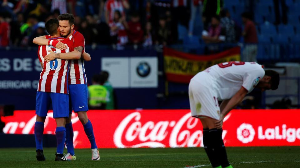 Atletico Madrid's Koke and Saul celebrate their victory over Sevilla FC in La Liga on Sunday.