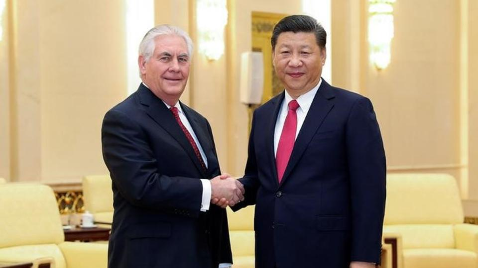 Chinese President Xi Jinping (R) shakes hands with US Secretary of State Rex Tillerson before their meeting at the Great Hall of the People on March 19, 2017 in Beijing.