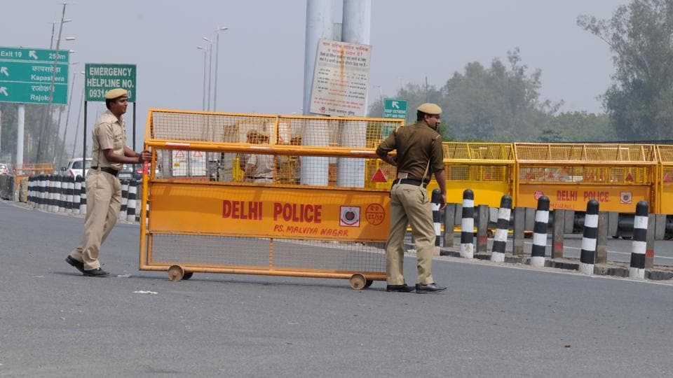 Delhi Police puts up a barricade to block the Delhi-Gurgaon Sarhaul border ahead of the Jat agitation which was to planned to take place on March 20 but was later called off.