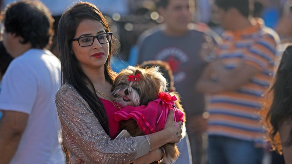 Close for comfort: A woman at the event with her dog. (Pratik Chorge/HT PHOTO)