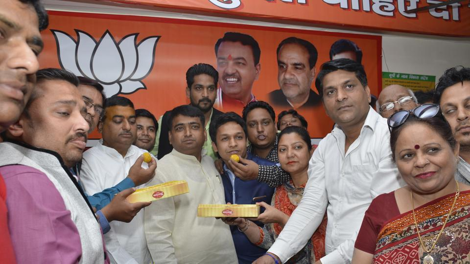 BJP supporters celebrate after Yogi Adityanath took oath as the chief minister.