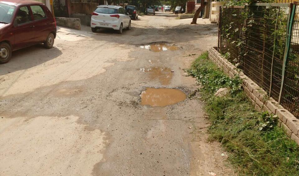 A potholed road at Huda Sector 21.