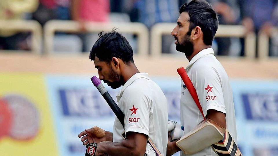 Wriddhiman Saha (L) and Cheteshwar Pujara set up a 199-run stand to help India wrest control of the third Test in Ranchi on Day 4.