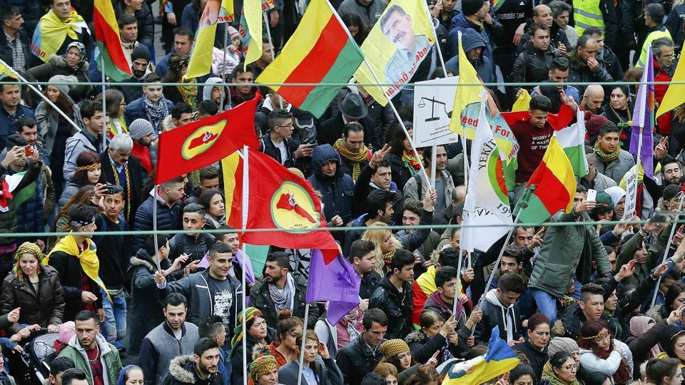 People hold placards during a demonstration organised by Kurds, in Frankfurt, Germany on Saturday.
