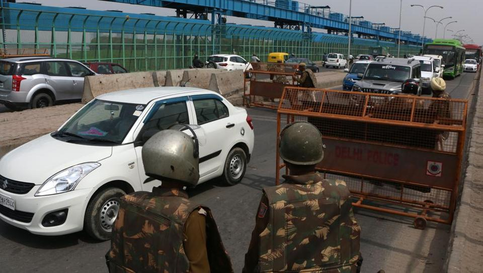 Security personnel man a barricade on the DND at Kalinidi Kunj on March 19, 2017.
