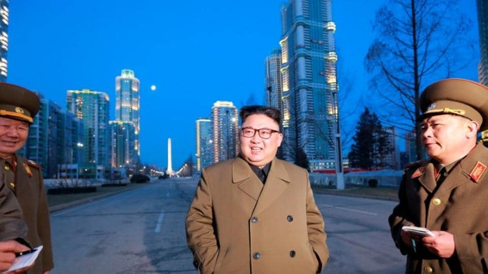 North Korean leader Kim Jong Un provides field guidance at the construction site of Ryomyong Street in this undated picture provided by KCNA in Pyongyang on March 16.