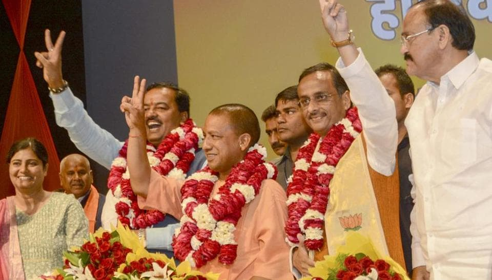 Yogi Adityanath (L) elected leader of the BJP legislature party; he will be sworn in as chief minister on Sunday. Deputy CM-designate Dinesh Sharma (R), Keshav Prasad Maurya (L) in Lucknow and Union minister Venkaiah Naidu can also be seen.